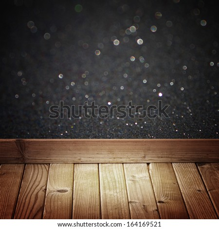 black glitter lights and wooden floor planks - stock photo