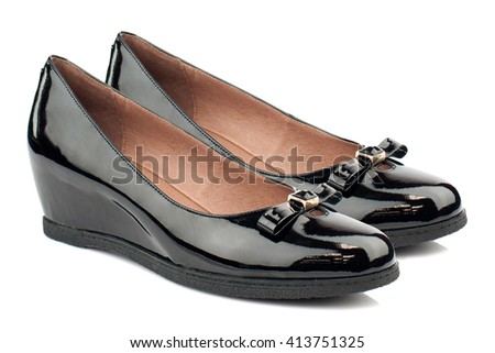 Black glossy women boat shoes isolated on white background.
