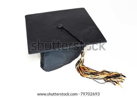 Black graduation cap with tassel on the white background. - stock photo