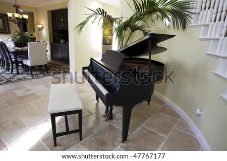 Black grand piano in luxury home. - stock photo