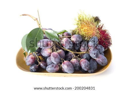 Black grapes and rambutan isolated on white background - stock photo