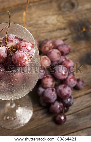 black grapes on wood board - stock photo