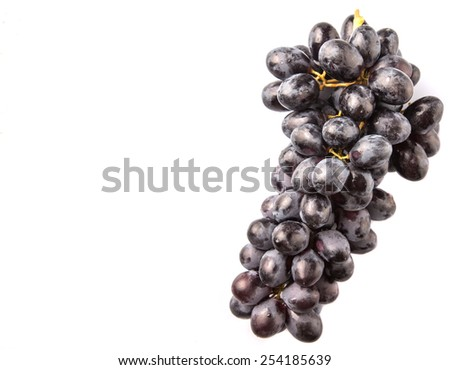 Black grapes over white background