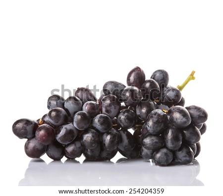 Black grapes over white background - stock photo
