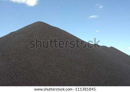 Black gravel mound mountain for concrete making - stock photo