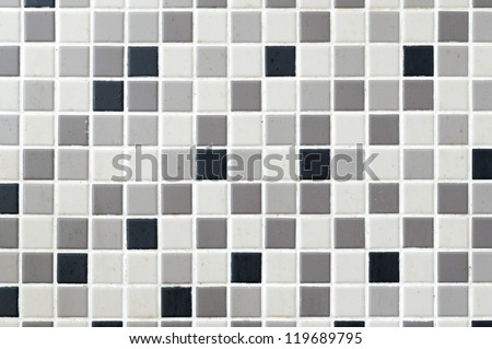 Black, grey, cream mosaic tile background - stock photo