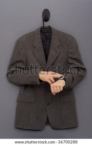 Black-Grey jacket with a mans hands touching his watch - stock photo