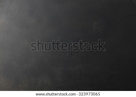 Black grunge textured background with copy space - stock photo