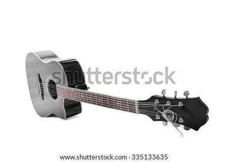 Black guitar on white background. - stock photo