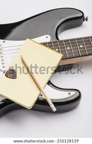 Black guitar with note pad