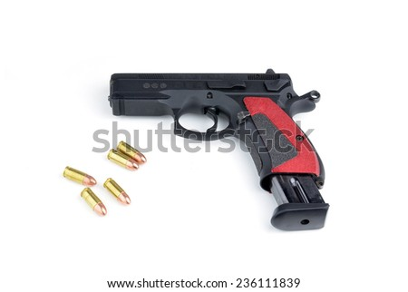 Black gun and 9mm bullets isolated a white background.