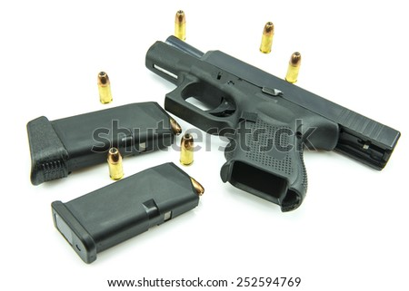 Black gun and 9mm bullets isolated a white background. - stock photo