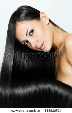 black hair , beautiful brunette woman with long natural hair , hairstyle. - stock photo