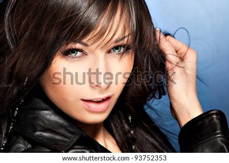 black hair blue eyes woman portrait in black leather jacket - stock photo