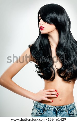 Black Hair. Fashion Girl Portrait. long  Hair and red lipstick. - stock photo
