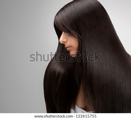 Black Hair. Portrait of Beautiful Woman with Long Hair. Good quality retouching.