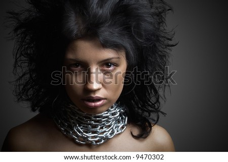 Black-haired  girl in chains - stock photo