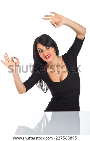 Black haired girl showing double OK with her fingers in a typical italian gesture