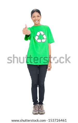 Black haired model wearing recycling tshirt giving thumb up on white background - stock photo