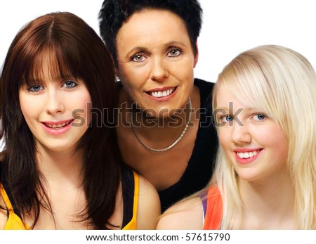 Black haired mother and one blond teenager and one brunette teenager girls portraits on white background