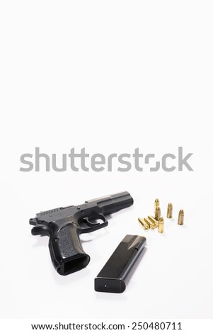Black Handgun and bullets on a white background. - stock photo