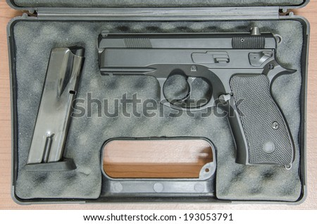black handgun and magazine in box - stock photo