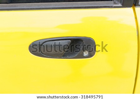 Black handle of the old yellow car - stock photo