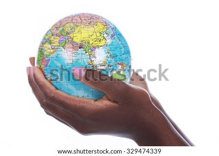 Black hands holding a world globe isolated on white