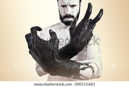 Black hands over ocher background - stock photo