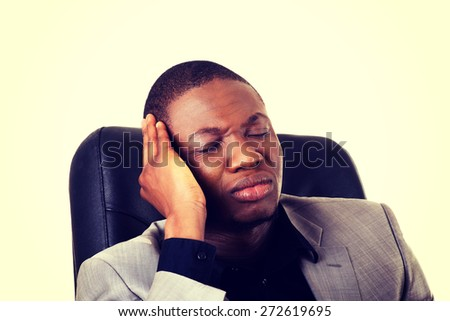 Black handsome man sitting at work