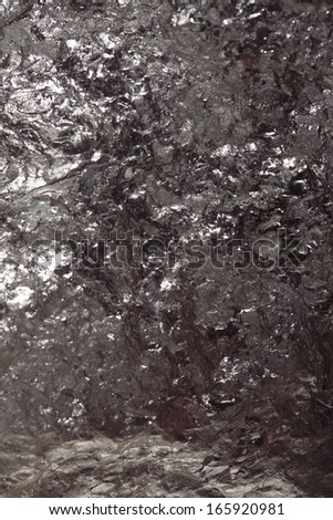 Black hard bituminous coal, carbon nugget closeup macro texture background. Power and energy source. - stock photo