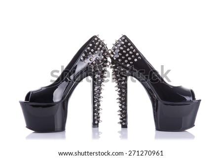 Black high heel shoes with spikes and studs, isolated on white background  - stock photo