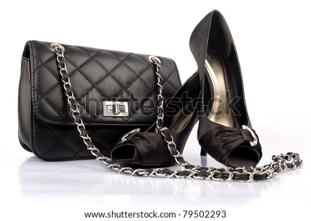 Black high heel women shoes and a bag on white background.
