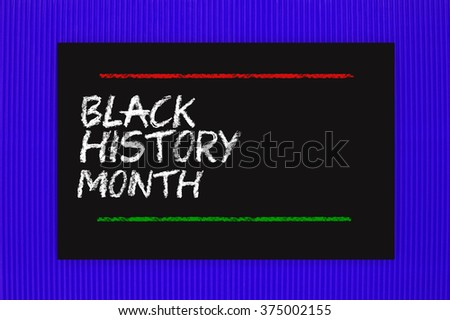 Black History Month Blackboard hanging on blue textured background - stock photo