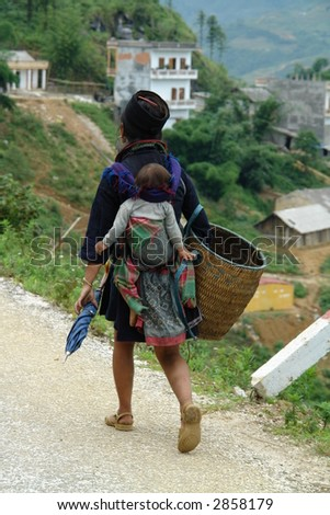 Black Hmong With Baby - stock photo