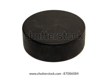 Black hockey puck isolated on white background - stock photo