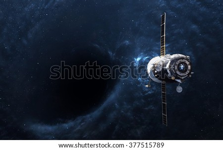 Black hole in space and spacecraft. Elements of this image furnished by NASA - stock photo