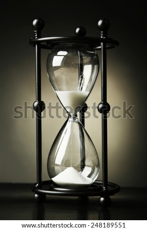 Black hourglass on black background
