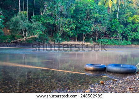 Black inflatable on the river  - stock photo
