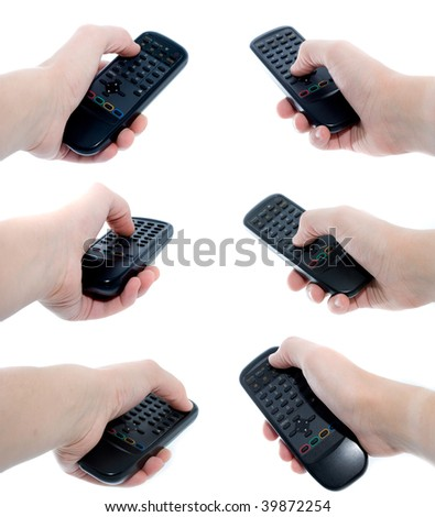 Black Infrared remote control unit in hand on a white background - big set - stock photo