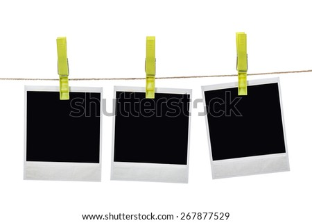 Black instant photo, hanging on the clothesline, isolated on white background.