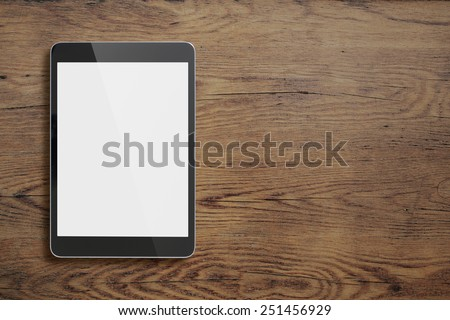 Black ipad on old wood table background  - stock photo