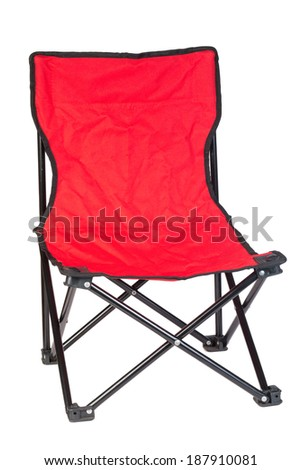 Black iron folding chair with red fabric on white background. - stock photo