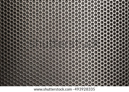 Black iron speaker grid texture background.
