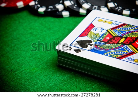 Black jack with black and red poker chips. - stock photo