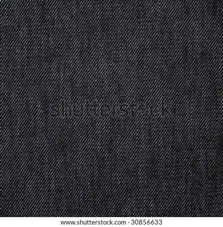 Black jeans fabric as background - stock photo