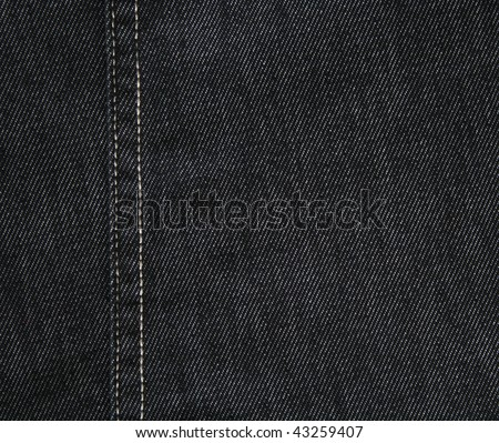 Black jeans fabric can use as background - stock photo