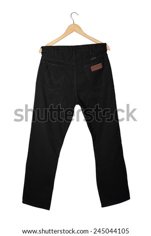 Black jeans on wooden hanger, isolated on white. - stock photo