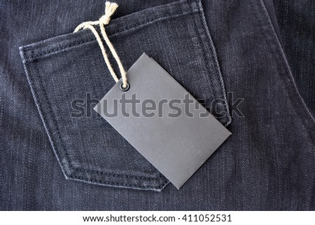 Black jeans with blank tag - stock photo