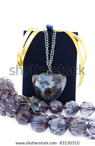 Black jewellery with crystal heart pendant and necklace. Isolated over white background. - stock photo